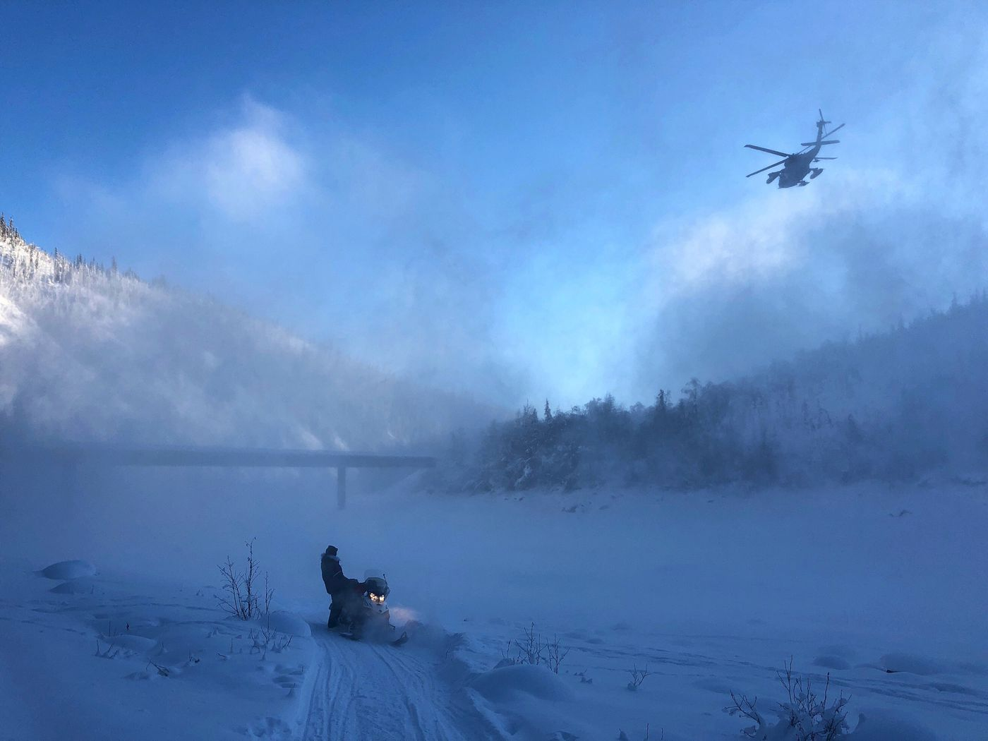 A helicopter from the Army's 52nd Aviation Regiment, based at Fort Wainwright, lifts off from the Fortymile River with Jason Campeau aboard on February 8, 2018. (Craig Jones photo)
