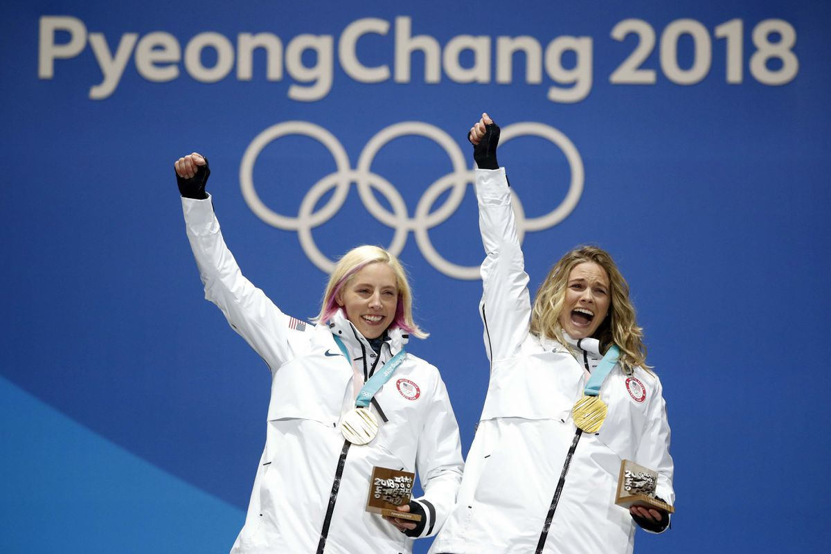 Kikkan Randall and Jessica Diggins celebrate on the podium after receiving their gold medals. (Kim Hong-Ji / Reuters)