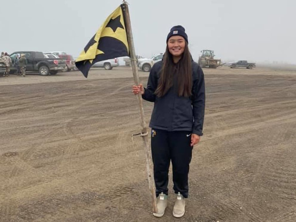 Jenilee Donovan brings the Quuniq Crew flag in on Tuesday, Aug. 25, 2020, after a successful hunt out of Utqiagvik. (Photo by Michael Quuniq Donovan)