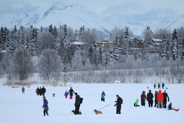 People ice skate on paths carved through the snow on Westchester Lagoon on Christmas Day, Tuesday, Dec. 25, 2018. (Bill Roth / ADN)