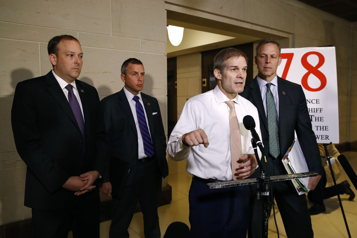 Rep. Jim Jordan, R-Ohio, second from right, speaks to members of the media after National Security Council director for European affairs Alexander Vindman arrived for a closed door meeting to testify as part of the House impeachment inquiry into President Donald Trump, Tuesday, Oct. 29, 2019, on Capitol Hill in Washington. (AP Photo/Patrick Semansky)
