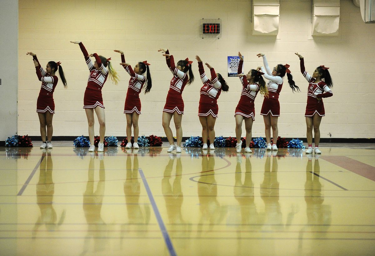 East Highcheerleaders mimic a shooting motion as they urge their team to victory at last week'sCook Inlet Conference tournament. (Bob Hallinen / ADN)