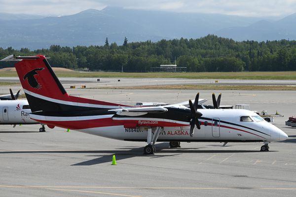A Ravn Alaska De Havilland Dash 8 parked near the terminal at Ted Stevens Anchorage International Airport on Tuesday, July 7, 2020. (Bill Roth / ADN)