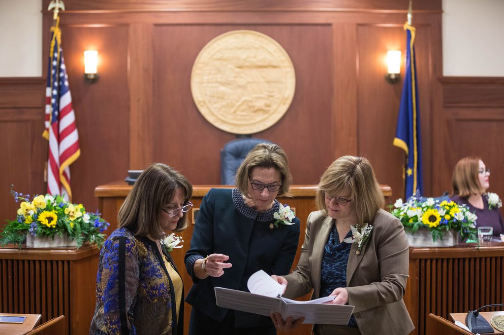 Alaska Senate president Cathy Giessel, R-Anchorage, center, confers with senators Lora Reinbold, R-Eagle River, left, and Mia Costello, R-Anchorage, on Tuesday, Jan. 15, 2019 at the Alaska State Capitol. (Loren Holmes / ADN)