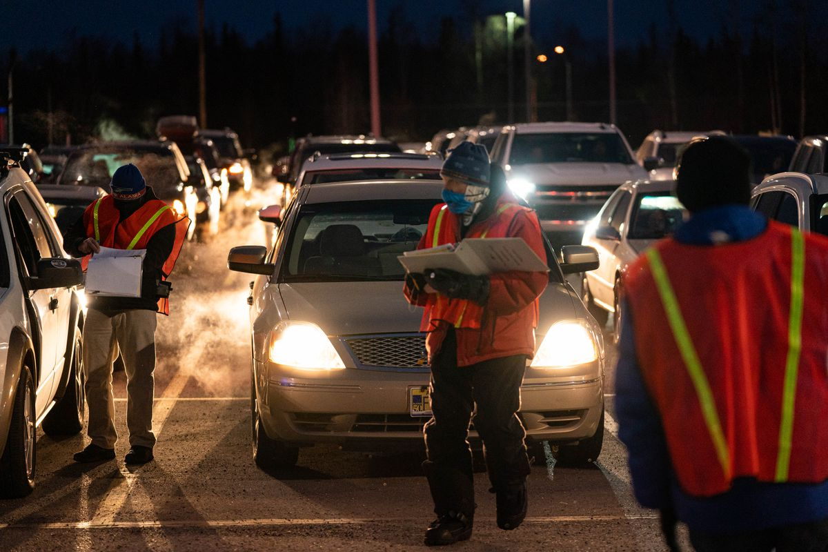 Volunteers register households and direct traffic at an emergency food distribution program run by the Food Bank of Alaska on Thursday, Nov. 5, 2020 at the former Sam's Club at Tikhatnu Commons in Anchorage. (Loren Holmes / ADN)