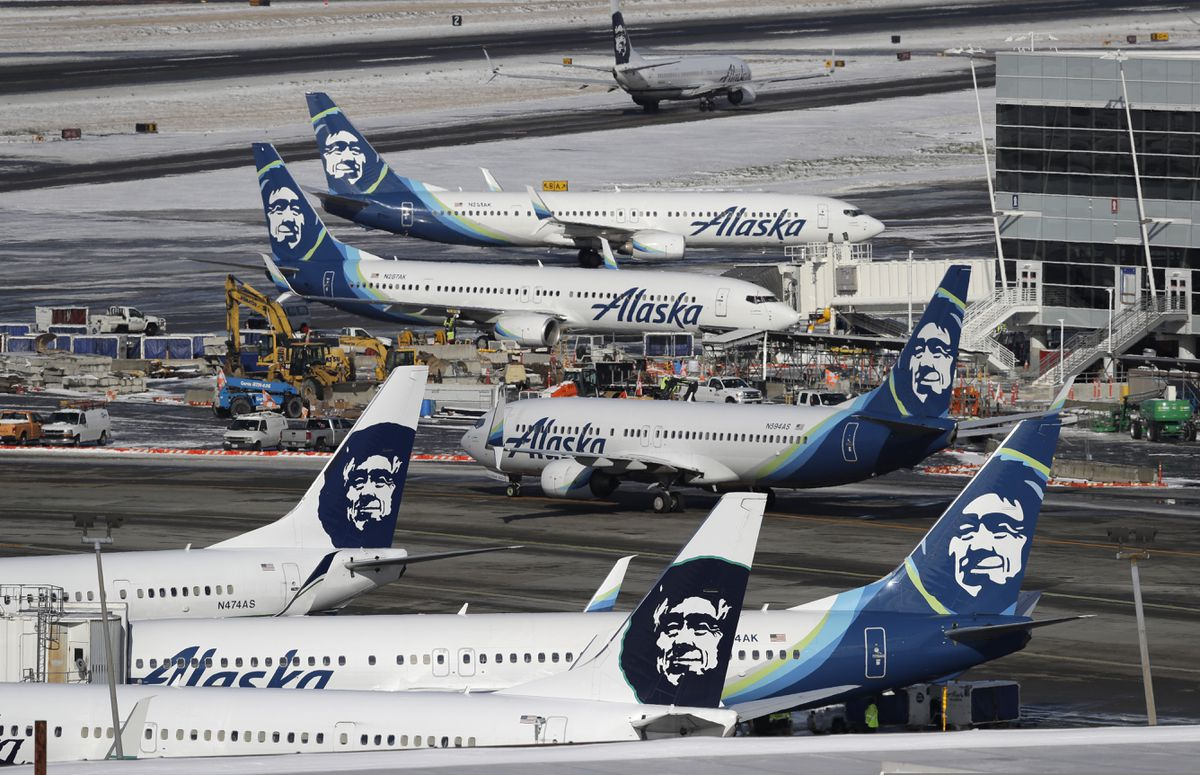 FILE - In this Feb. 5, 2019, file photo, Alaska Airlines planes are parked at a gate area at Seattle-Tacoma International Airport in Seattle. (AP Photo/Ted S. Warren, File)