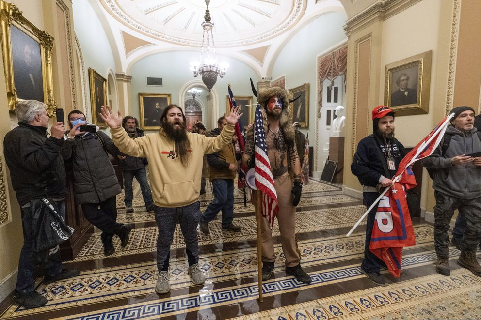 FILE - In this Wednesday, Jan. 6, 2021 file photo, supporters of President Donald Trump are confronted by U.S. Capitol Police officers outside the Senate Chamber inside the Capitol in Washington. (AP Photo/Manuel Balce Ceneta)