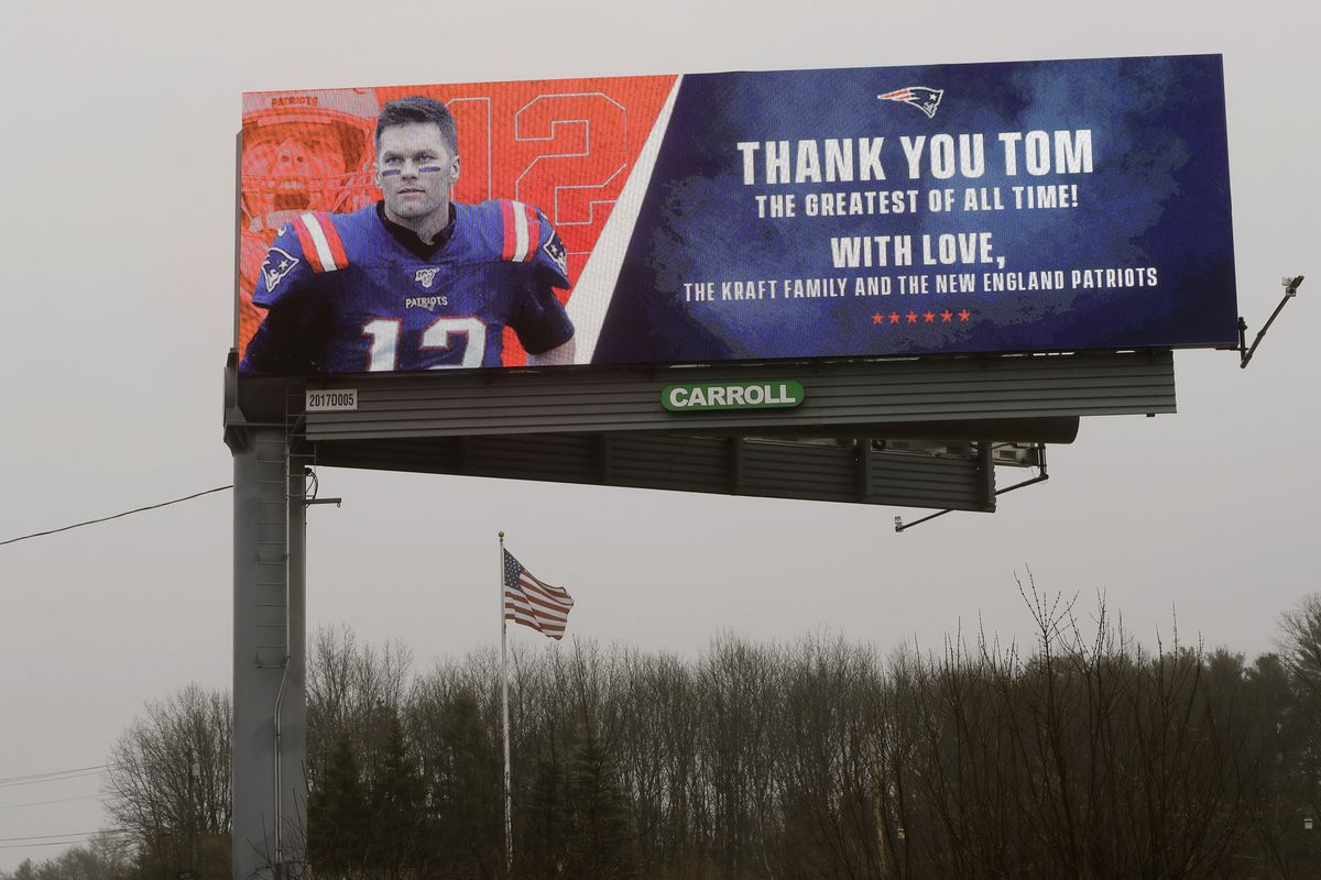 A billboard featuring an image of former New England Patriots quarterback Tom Brady stands along Route 1, in Walpole, Mass., about a mile from Gillette Stadium, which is in Foxborough, Mass., Thursday, March 19, 2020. The Kraft family and the New England Patriots signed off on a message on the sign meant to honor the quarterback. Robert Kraft is the owner of the football team. Brady said on social media on Tuesday, March 17, 2020 that he would not be returning to the Patriots and has become a free agent. (AP Photo/Steven Senne)