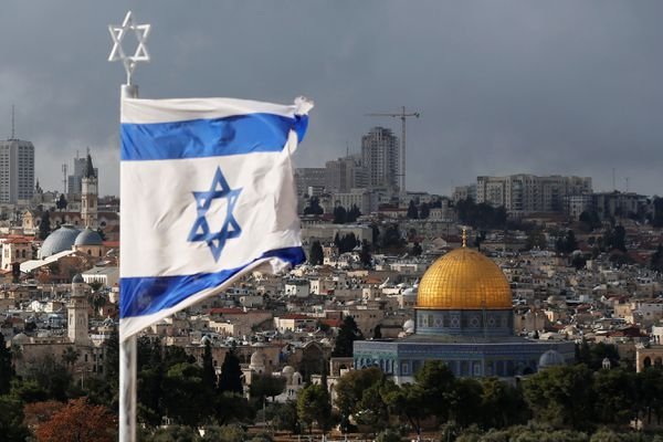 An Israeli flag is seen near the Dome of the Rock, located in Jerusalem's Old City on the compound known to Muslims as Noble Sanctuary and to Jews as Temple Mount December 6, 2017. REUTERS/Ammar Awad