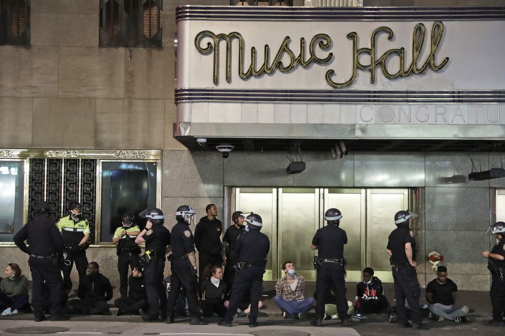 Police officers arrest a large group of people at Radio City Music Hall in New York, Monday, June 1, 2020. Demonstrators took to the streets of New York City to protest the death of George Floyd, a black man who died in police custody in Minneapolis on May 25. (AP Photo/Seth Wenig)