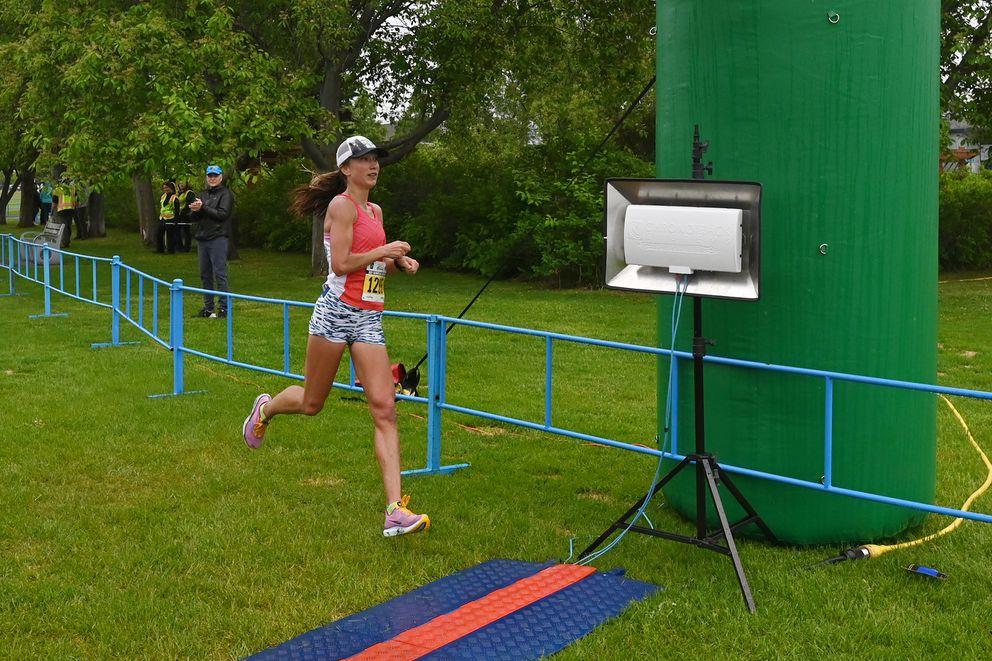 Anna Dalton claims the women's half marathon victory. (Bill Roth / ADN)