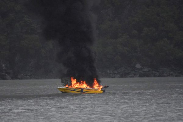 A small fishing charter boat burns near the Whittier harbor, Friday Sept. 13, 2019. (Photo by Dennis C. Jones)