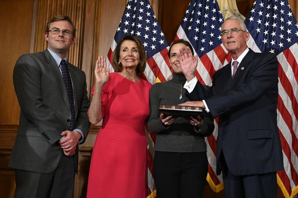 """FILE - In this Jan. 3, 2019, file photo, House Speaker Nancy Pelosi of Calif., second from left, poses during a ceremonial swearing-in with Rep. Francis Rooney, R-Fla., right, on Capitol Hill in Washington. said out loud Friday, Oct. 19, what others in his party are not, namely that White House Chief of Staff Mick Mulvaney acknowledged a """"quid pro quo"""" was at work when Trump held up U.S. aid to Ukraine in exchange for Kyiv's investigation of Democrats and the 2016 elections. Mulvaney later claimed his comments had been misconstrued, but Rooney says he and other Republicans heard them clearly. (AP Photo/Susan Walsh, File)"""