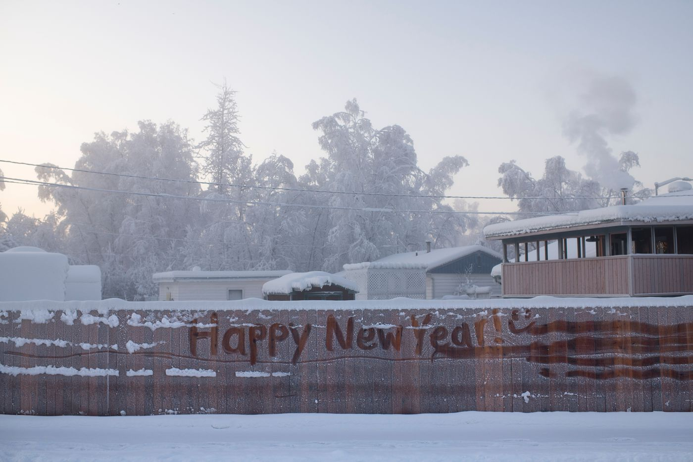 A greeting is written in frost in a residential neighborhood of Fairbanks. (Marc Lester / ADN)