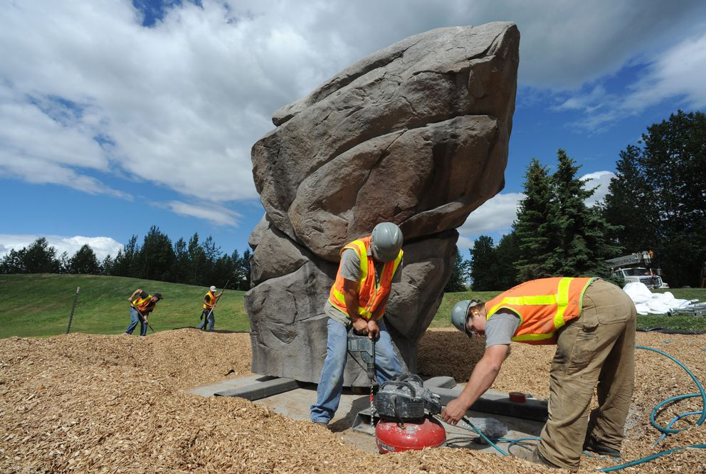 Workers from GMG General installed a new climbing boulder at Sitka Street Park on Tuesday, June 28, 2016. The boulder was manufactured by IDSculpture in Gunnison, CO, with project funding provided by the Anchorage Park Foundation. (Bill Roth / Alaska Dispatch News)