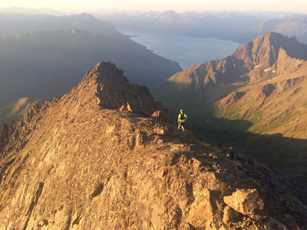 Lars Arneson hikes the North Suicide ridge on July 22, the day he and Peter Mamrol climbed 12 Chugach Mountain peaks in a record 18 hours, 10 minutes. (Photo by Peter Mamrol)