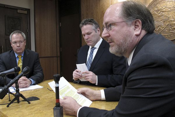 This photo from Jan. 30, 2019, shows Attorney General Kevin Clarkson, right, during a news conference with state Revenue Commissioner Bruce Tangeman, left, and Gov. Mike Dunleavy, center, in Juneau, Alaska. A state Department of Law spokeswoman said Clarkson was doing well after suffering a heart attack. (AP Photo/Becky Bohrer)