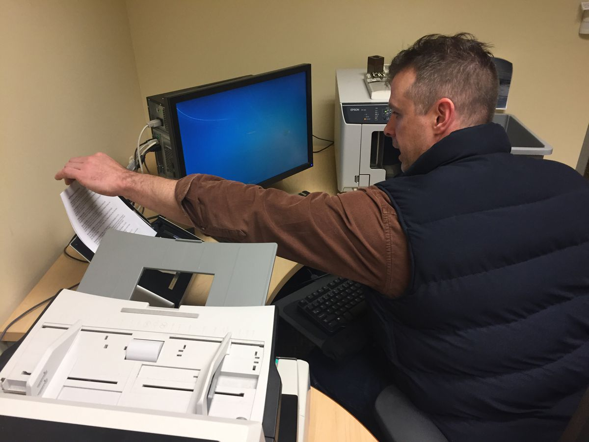John Callahan, a spokesman for the Bureau of Ocean Energy Management, faxes paperwork to his boss at the agency's national headquarters early Monday. The paperwork acknowledges details of his furlough, caused by a government shutdown. (Alex DeMarban / ADN)