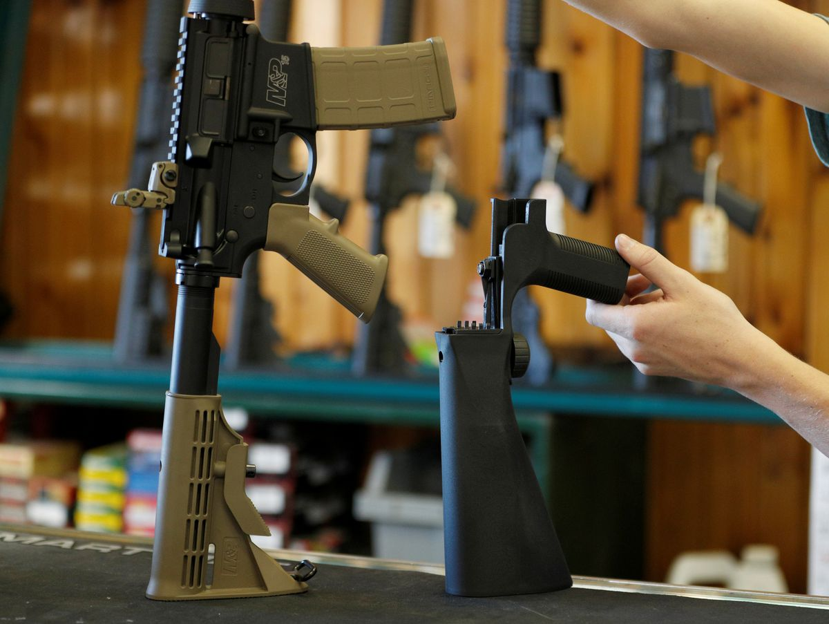 A bump fire stock, right, attaches to a semiautomatic rifle to increase the firing rate, seen at Good Guys Gun Shop in Orem, Utah, October 4, 2017. REUTERS/George Frey