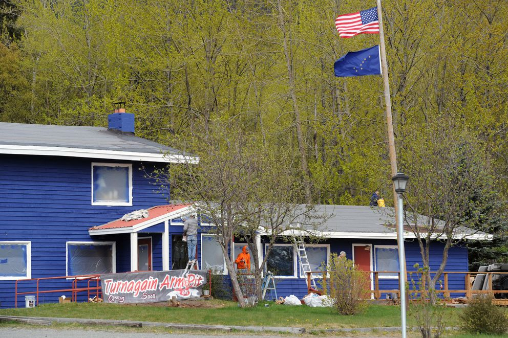 The former Turnagain House restaurant transitions from brown to blue in April 2016 in advance of re-opening as Turnagain Arm Pit BBQ in Indian. The barbecue restaurant is located at Mile 103 on the Seward Highway. (Erik Hill / ADN archive 2016)