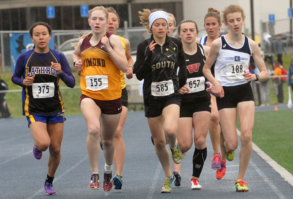 Competitors in the Division I girls 800 meters including Lathrop's Laura Alvanna (375), Dimond's Kylie Judd (155), South's Ava Earl (585), Wasilla's Allison VanPelt (657) and Eagle River's Emily Walsh race during the ASAA/First National Bank Alaska Division I Track and Field Championships at Machetanz Field in Palmer on Saturday, May 25, 2019. VanPelt won the race. (Matt Tunseth / ADN)