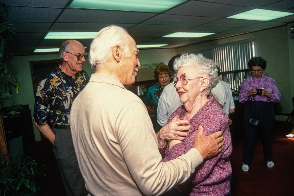 Peggy Lott greets former 'regulars ' and employees at a reunion in her honor last week. Harris Hancock (left) was one of Peggy's first customers. June 1, 1994. (Jim Lavrakas / ADN Archive 1994)