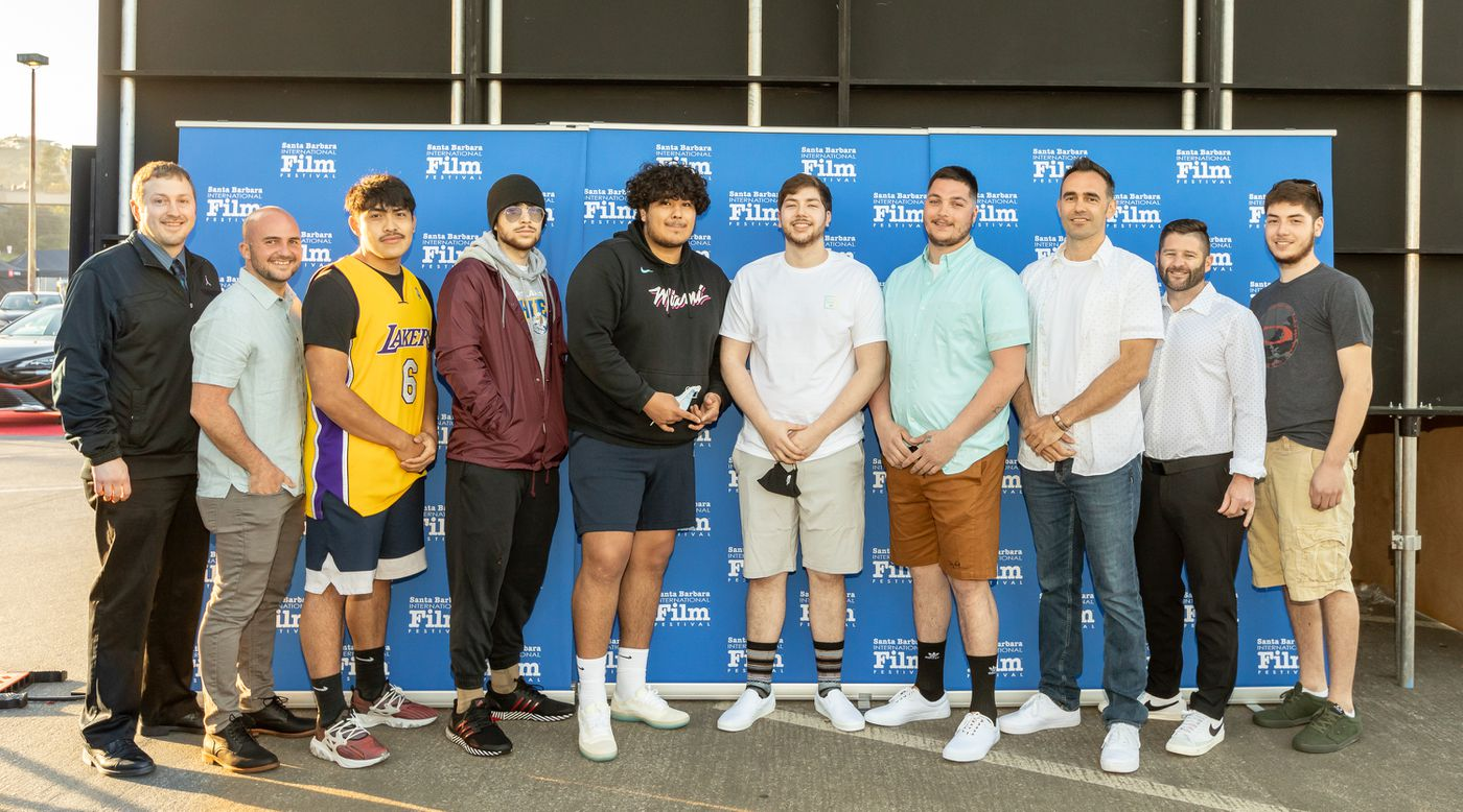 From left, Metlakatla basketball coach TJ Scott, producer Ryan Rossman, players Christian Hayward, Tyler Henderson, CJ Hudson, DJ King and Danny Marsden, director Jeff Harasimowicz, producer Ryan Welch and player Hunter Winter gather for a photo at the Santa Barbara International Film Festival before the premier of 'Alaskan Nets ' earlier this month in Santa Barbara, California. (Photo courtesy TJ Scott)
