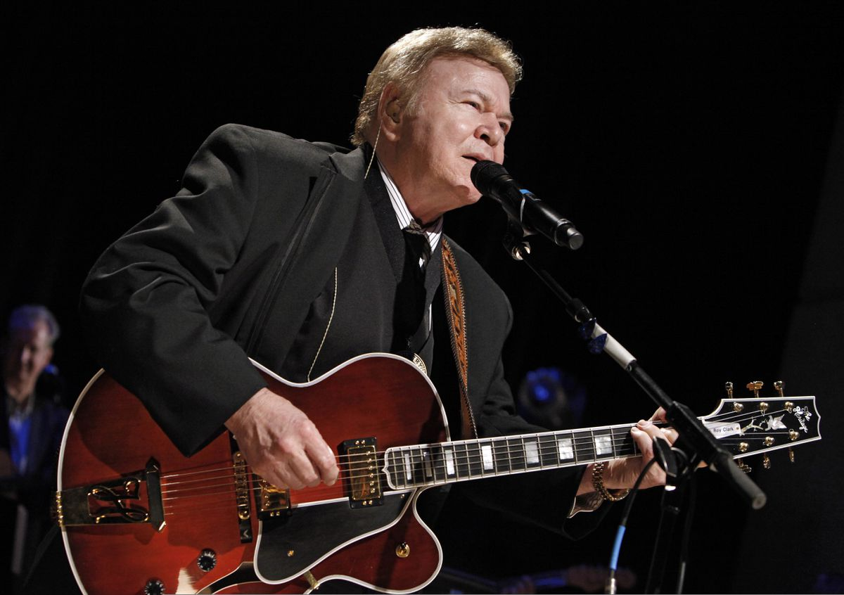 FILE - In this May 17, 2009, file photo, country music star Roy Clark performs after being inducted into the Country Music Hall of Fame in Nashville, Tenn. Clark, the guitar virtuoso and singer who headlined the cornpone TV show