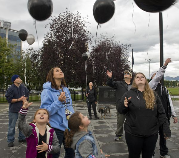 About 35 people released balloons Thursday on the Delaney Park Strip in memory of people who have died of drug overdoses. Some participated to show support for people struggling with addiction, as part of the Overdose Awareness Day event. (Marc Lester / Alaska Dispatch News)
