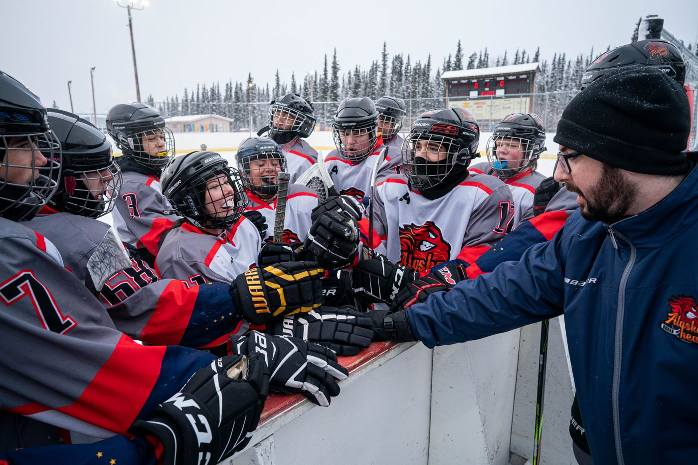 Alaska Heat head coach Alex Andrews leads his team in a cheer before Saturday morning's game. (Loren Holmes / ADN)