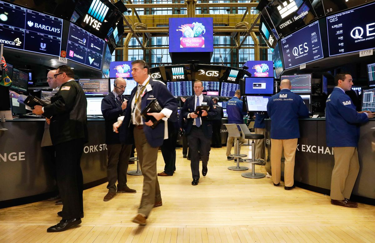 Traders work on the floor of the New York Stock Exchange on Friday. REUTERS/Brendan Mcdermid
