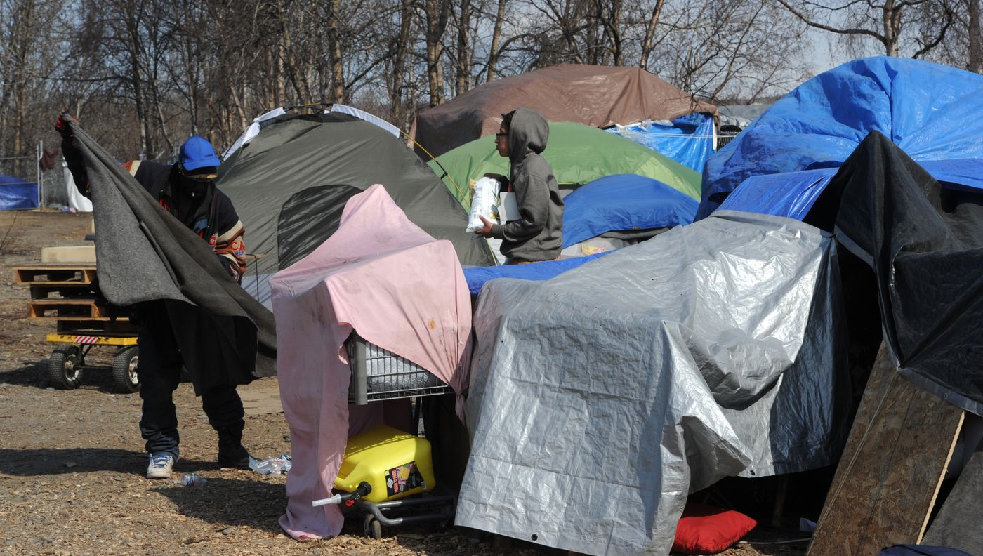 Anchorage Police informed people at an illegal homeless camp at Third Avenue and Ingra Street on Thursday, April 30, 2020, that they should clear out before the camp is abated in 10 days. (Bill Roth / ADN)