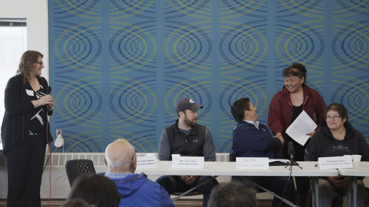Lucy Henson greets panelists at the Thursday, June 6, 2019 meeting in Kotzebue. From left, Arctic Sounder reporter Shady Grove Oliver, event moderator; Rep. John Lincoln; John Moller, policy advisor to Gov. Mike Dunleavy; Lucy Nelson, mayor of the Northwest Arctic Borough; and Tia Wakolee, author. (Nadia Sussman / ProPublica)