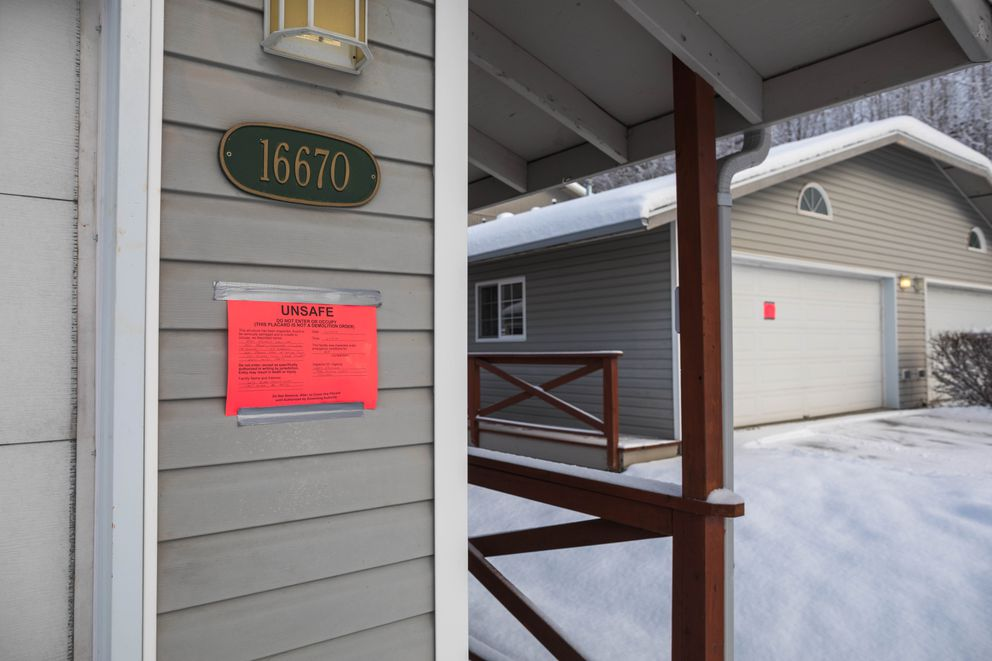 Homes are red-tagged, indicating that they are unsafe to occupy, at the Rivers Edge Condominiums in Eagle River on Dec. 13, 2018. Eight homes were red-tagged by the municipality due to structural damage that occurred when part of a slope slid into the homes during the Nov. 30, 2018, magnitude 7.1 earthquake. (Loren Holmes / ADN)
