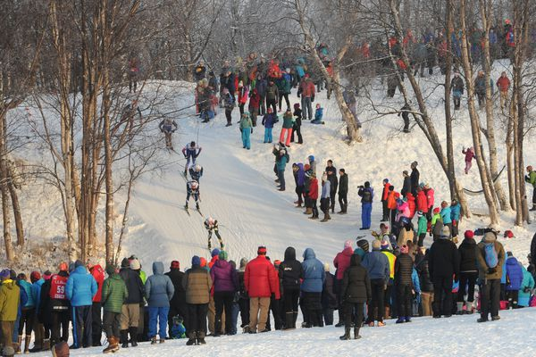 Spectators line the course to watch the men's freestyle sprint final during the U.S. Cross Country Skiing Championships at Kincaid Park on Friday, Jan. 5, 2018. (Bill Roth / ADN)