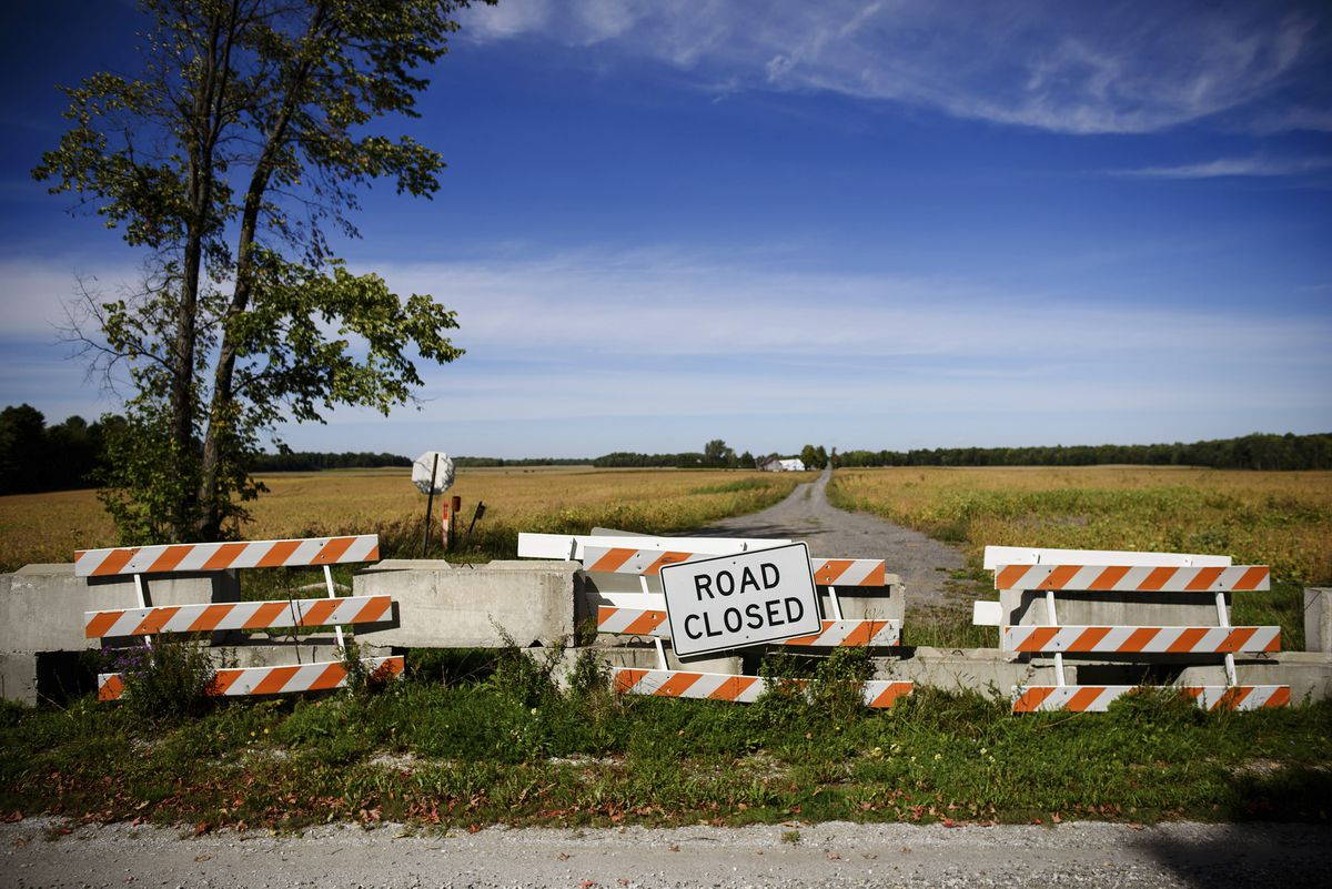 A barricade blocks a road that leads to Canada along VermontÕs 90-mile border with the country, in Alburgh, Sept. 21, 2016. The Northern border of the United States is nearly three times the Southern border's length, but the Border Patrol in the North makes do with about one-tenth the manpower. (Jacob Hannah / The New York Times)