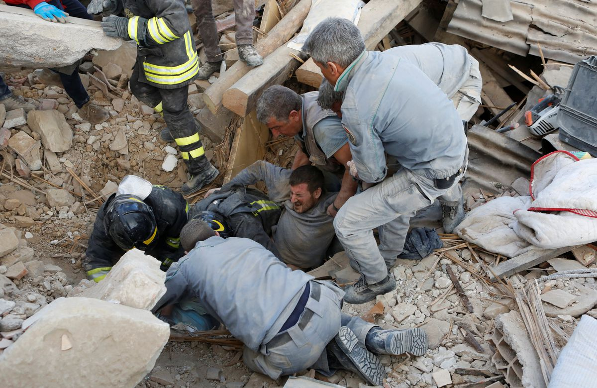 A man is rescued alive from the ruins following an earthquake in Amatrice, central Italy, on Aug. 24, 2016. (Remo Casilli / Reuters)