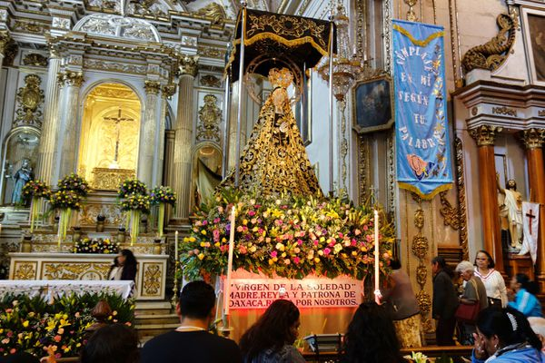 On her feast day, the statue of Oaxaca's patron saint, Our Lady of Solitude (Nuestra Señora de la Soledad), is decorated with flowers. The statue is inside the Basilica of Our Lady of Solitude in Oaxaca, a brief walk from the city center. (Photo: Scott McMurren)