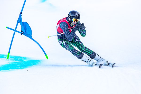 Alyeska Ski Club U19 Max Johnsen arcs toward the finish line in the first run in the second of two Coca-Cola Classic giant slaloms on Alyeska's Race Trail Wednesday, Jan. 27, 2021. In both races he won the U19 class and was second overall to U16 Finnigan Donley. (Photo by Bob Eastaugh)