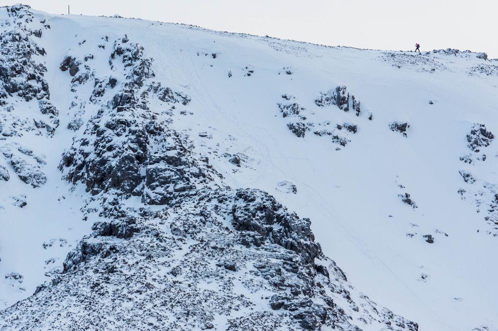 A hiker walks along the edge of Flattop Mountain on Saturday, December 27, 2014. (Loren Holmes / Alaska Dispatch News)