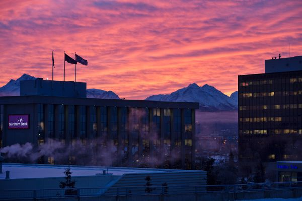 Clouds glow over the Chugach Mountains in this view from Midtown Anchorage on winter solstice, December 21, 2017. (Marc Lester/ ADN)