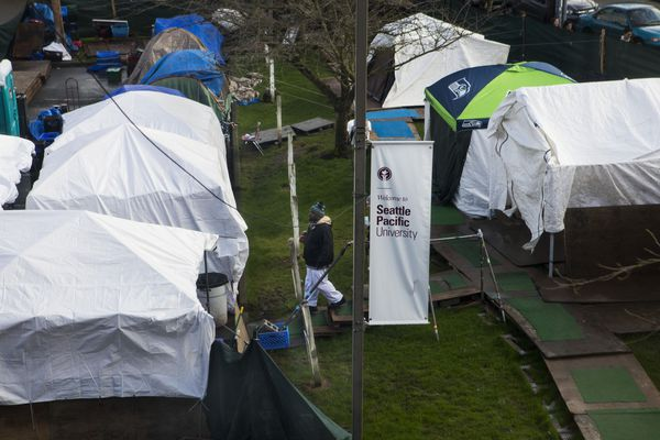 Tent City 3, a homeless encampment on the grounds of Seattle Pacific University in Washington state, Feb. 9, 2018. Homeless encampments are bleakly familiar fixtures in cities. But here in the Puget Sound area, which struggles with one of the nation's worst homelessness problems, an unusual arrangement has taken root: homeless camps with rights and rules. (Ruth Fremson/The New York Times)