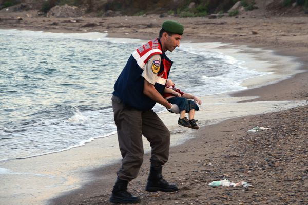 A paramilitary police officer carries the lifeless body of Aylan Kurdi, 3, after a number of migrants died and a smaller number were reported missing after boats carrying them to the Greek island of Kos capsized, near the Turkish resort of Bodrum on Wednesday.