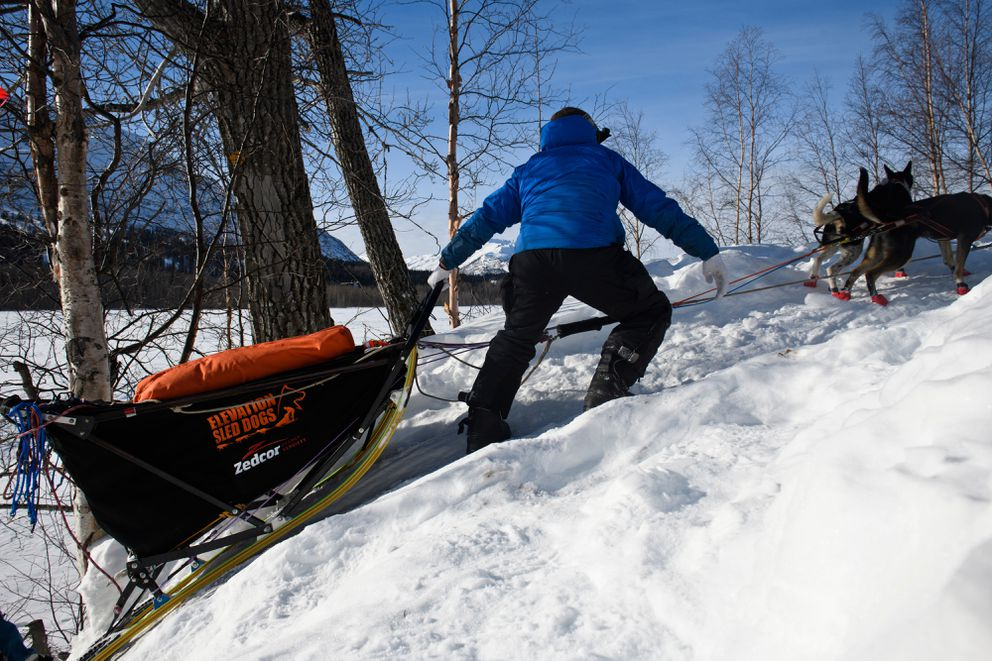 Aaron Peck climbs a steep section of trail near the Skwentna River on March 4, 2019. (Marc Lester / ADN)