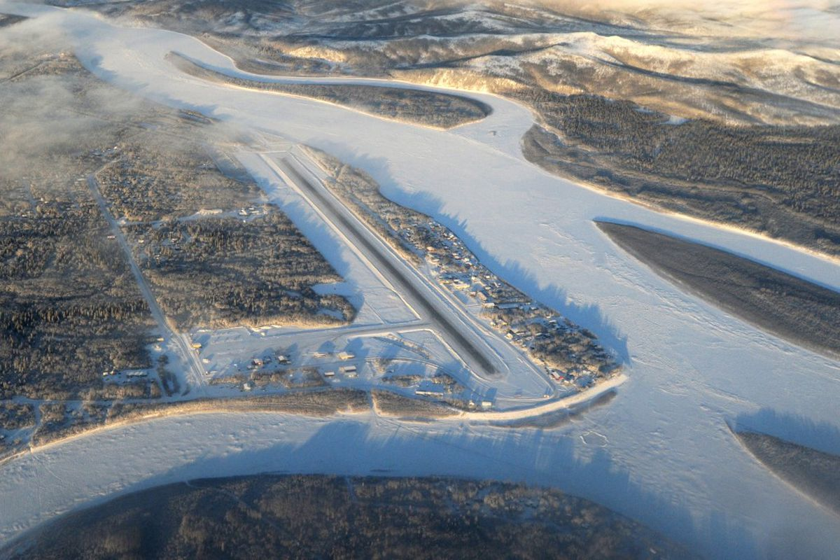 Aerial view of the Aniak Airport on Thursday, Jan. 12, 2017. Aniak Slough, lower left, and the Kuskokwim River, right, border the village of Aniak. (Bill Roth / ADN)