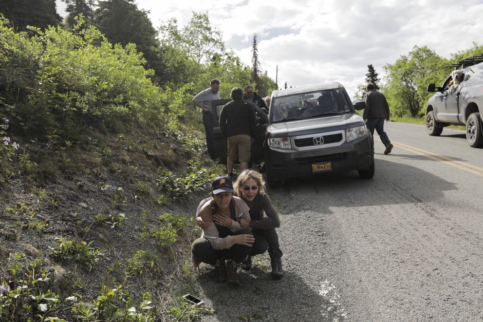 Wendi Yohman is comforted after a man was mauled by a bear Wednesday in Eagle River. The man was searching for Yohman's cousin Mike Soltis, who went missing Monday. (Loren Holmes / ADN)