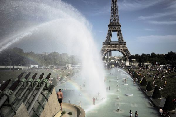 People cool off in the fountains of the Trocadero gardens, in front of the Eiffel Tower, in Paris, Friday, June 28, 2019. Schools are spraying kids with water and nursing homes are equipping the elderly with hydration sensors as France and other nations battle a record-setting heat wave baking much of Europe. On Thursday, July 18, 2019, the U.S. National Oceanic and Atmospheric Administration announced that June averaged 60.6 degrees (15.9 Celsius), about 1.7 degrees (0.9 Celsius) warmer than the 20th century average. It beat out 2016 for the hottest June with records going back to 1880. (AP Photo/Lewis Joly)