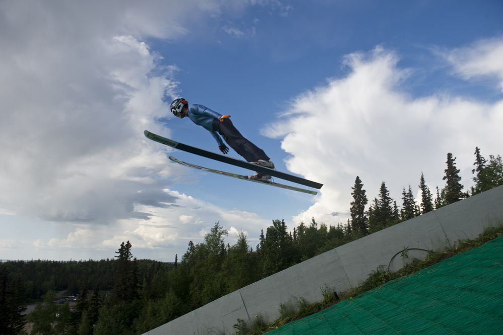 Carter Brubaker, of Anchorage, flies over the 65-meter ski jump at the Karl Eid Ski Jump Complex on June 10, 2019. Brubaker was named to the USA Nordic Junior National team in Nordic combined. (Marc Lester / ADN)
