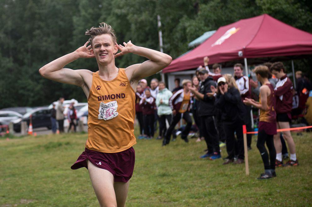 Niko Latva-Kiskola celebrates at the finish line after anchoring the Dimond boys relay team. (Marc Lester / ADN)