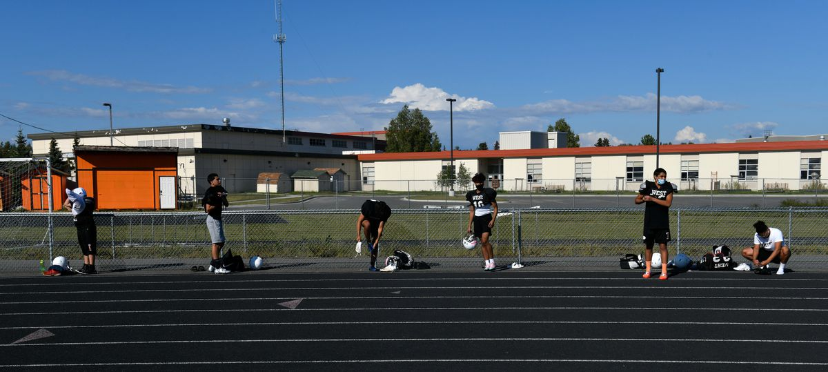 West High football players spread out while they suit up for practice Thursday. (Marc Lester / ADN)